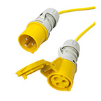 Image of a yellow, 110 volt, 16 amp plug and socket on the ends of an extension lead.